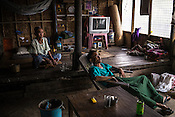 A family of rice farmers, U Hla Kyi (84) and his son, Ukhim Ng Swe (55) seen resting in their house in A Si Gyi village in Pyapon district of Myanmar.