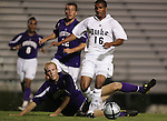 Duke's Zach Pope (16) avoids a tackle by Western Illinois's Luke Greenwell (below) on Tuesday, October 11th, 2005 at Duke University's Koskinen Stadium in Durham, North Carolina. The Duke University Blue Devils defeated the Western Illinois Leathernecks 2-0 during an NCAA Division I Men's Soccer game.