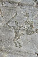Petroglyph, rock carving, of a warriors with a shield and sword. Carved by the ancient Camunni people in the iron age between 1000-1200 BC. Rock no 24, Foppi di Nadro, Riserva Naturale Incisioni Rupestri di Ceto, Cimbergo e Paspardo, Capo di Ponti, Valcamonica (Val Camonica), Lombardy plain, Italy