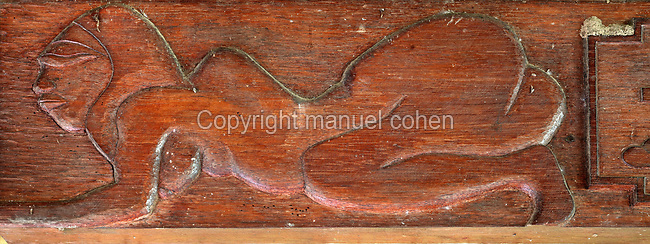 Wooden carving of a naked Marquesian woman, in the Paul Gauguin Cultural Center, a museum which opened in 2003, in Atuona, on the island of Hiva Oa, in the Marquesas Islands, French Polynesia. The museum includes a reconstruction of the Maison du Jouir or House of Pleasure, home to French artist Paul Gauguin, 1848-1903, from 1901 to his death, a traditional 2-storey hut with a wooden lintel carved by Gauguin in 1901 with the inscription, 'Be mysterious. Be loving and you will be happy'. Picture by Manuel Cohen