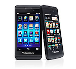 Two Blackberry Z10 smartphones with desktop and app store on display. Black phones isolated on white background with clipping path