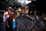 Janeth Hammid and her children stand in the burned out ruins of their mosque, The Islamic Center of Savannah. It was torched by an arsonist who was never apprehended. Savannah, Georgia. September 2003