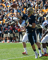 Pitt quarterback Nate Peterman. The Pitt Panthers football team defeated the Virginia Cavaliers 26-19 on Saturday October 10, 2015 at Heinz Field, Pittsburgh, Pennsylvania.