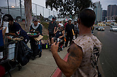 San Diego, California<br /> July 13, 0212<br /> <br /> &quot;Stand Down&quot; held by Veterans Village San Diego. It is a three day event attended by 1,000+ homeless vets annually. <br /> <br /> At 5am most of the attendees to the &quot;Stand Down&quot; wait in line outside of the grounds and many slept overnight at the entrance. <br /> <br /> It provides them with shower facilities, hair cuts, and clothing. Also with direct access to the Veterans Affairs they have possibilities for housing and medical attention as well as help for substance abuse.
