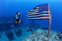 pk0104-D. scuba diver (model released) pays homage to our flag. wreck of the Spiegel Grove, a 510-foot long ship intentionally sunk to create an artificial reef for scuba divers. Florida Keys, FL, USA, Atlantic Ocean..Photo Copyright © Brandon Cole. All rights reserved worldwide.  www.brandoncole.com..This photo is NOT free. It is NOT in the public domain. This photo is a Copyrighted Work, registered with the US Copyright Office. .Rights to reproduction of photograph granted only upon payment in full of agreed upon licensing fee. Any use of this photo prior to such payment is an infringement of copyright and punishable by fines up to  $150,000 USD...Brandon Cole.MARINE PHOTOGRAPHY.http://www.brandoncole.com.email: brandoncole@msn.com.4917 N. Boeing Rd..Spokane Valley, WA  99206  USA.tel: 509-535-3489