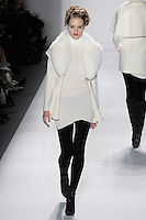 Model walks runway in an ivory handloomed cashmere/silk ribbed vest w/fox collar, and ivory handlomed cashmere/silk ribbed turtleneck+velvet leggings, from the Zang Toi Fall 2012 &quot;Glamour At Gstaad&quot; collection, during Mercedes-Benz Fashion Week New York Fall 2012 at Lincoln Center.