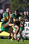 David Raikuna fights his way out of Kato Nganeko's tackle. Counties Manukau Premier Club Rugby game between Pukekohe and Waiuku played at Colin Lawrie Fields, Pukekohe, on Saturday July 3rd 2010. Pukekohe won 31 - 12 after leading 15 - 9 at halftime.