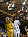 22 March 2014: Duke's Elizabeth Williams (right) is fouled by Winthrop's Schaquilla Nunn (left). The Duke University Blue Devils played the Winthrop University Eagles in an NCAA Division I Women's Basketball Tournament First Round game at Cameron Indoor Stadium in Durham, North Carolina.