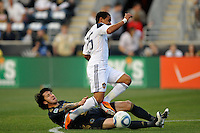 Danny Califf (4) of the Philadelphia Union attempts a tackle on Miguel Lopez (25) of the Los Angeles Galaxy. The Philadelphia Union  and the Los Angeles Galaxy played to a 1-1 tie during a Major League Soccer (MLS) match at PPL Park in Chester, PA, on May 11, 2011.