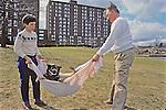 Joni Praded Carrying Dog