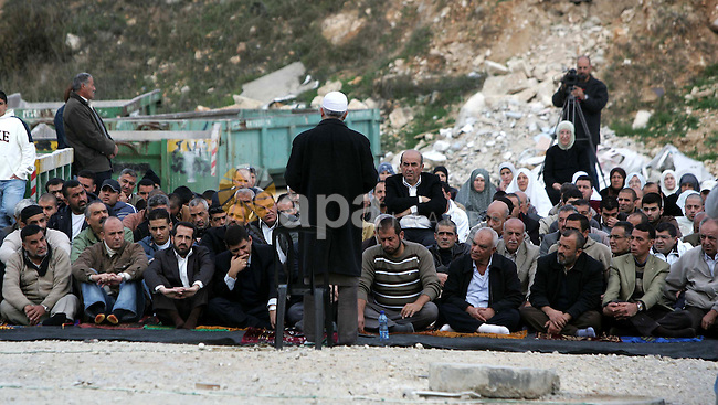 Head of the islamic movement in Israel,Sheikh Raed Salah ttends Friday prayers near the house of the evicted Palestinian Kurd family in east Jerusalem's the Sheikh Jarrah neighbourhood on December 4, 2009. Photo by Mohamar Awad