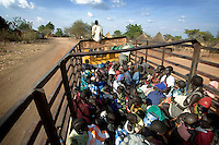 Dinka women and children travel on a truck taking them from a camp for displaced persons to a barge on the River Nile which will return them to their homeland of Bor.  The resettlement programme following the civil war is organised by the IOM (International Organisation for Migration).  Tens of thousands of Dinka tribespeople are among the estimated 3.8 million people displaced during the two-decade long conflict between the government and the SPLA (Sudanese People Liberation Army)...