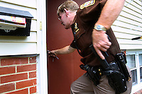 Deputy Rick Booth from the Manassas Sheriff Office in Virginia breaks into a foreclosed house after he found the locks had been changed. The area is suffering from a major collapse in the housing market following the subprime crisis and global credit crunch, which has forced the foreclosure and abandonment of numerous properties...