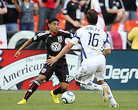 Cristian Castillo #12 of D.C.United moves past Josh Wolff #16 of the Kansas City Wizards during an MLS match at RFK Stadium on May 5 2010, in Washington DC. United won 2-1