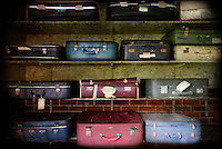 Suitcases on shelves at West Park abandoned asylum