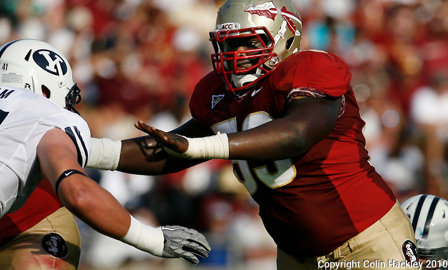 TALLAHASSEE, FL 9/18/10-FSU-BYU FB10 CH-Florida State's Henry Orelus, right, keeps Brigham Young's Matt Putnam at bay during second half action Saturday at Doak Campbell Stadium in Tallahassee. The Seminoles beat the Cougars 34-10. .COLIN HACKLEY PHOTO