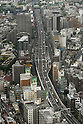 May 10, 2010 - Tokyo, Japan - Cars move along an expressway in Tokyo, Japan, on May 10, 2010. To lower transportation cost as well as revitalizing local economies, the Hatoyama government has decided to abolish tolls, on an experimental basis, for 50 sections of 37 expressways in Japan on trial basis from June 2010 till the end of March 2011. The transport ministry predicted the plan will help curtail CO2 emissions, while the Environment Ministry said it will not.