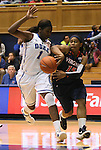 02 January 2012: Virginia's Ariana Moorer (15) passes the ball around Duke's Elizabeth Williams (1). The Duke University Blue Devils defeated the University of Virginia Cavaliers 77-66 at Cameron Indoor Stadium in Durham, North Carolina in an NCAA Division I Women's basketball game.