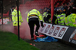 Grimsby Town 1 Lincoln City 3, 28/12/2014. Blundell Park, Football Conference. Stewards attempt to extinguish a red flare thrown by Lincoln fans.  Photo by Paul Thompson.