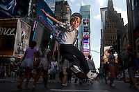 New York, NY - July 05, 2013 : 10-year-old tap dancer Luke Spring in Times Square in New York, NY on  July 05, 2013. Luke Spring, a dance prodigy from Stuio Bleu Dance Center in Ashburn, VA, has performed on the Tonys, Ellen, So You Think You Can Dance and The Ford Gala. His sisters Cami Spring, 20, and Lucy Spring, 18, are both award winning dancers. (Photo by Melanie Burford/Prime for The Washington Post)
