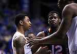 Kentucky center Dakari Johnson separates Tyler Ulis from Auburn Players during the first half of the Semifinal game of the SEC tournament against Auburn in Nashville , Tenn., on Saturday, March 14, 2015. Photo by Jonathan Krueger | Staff