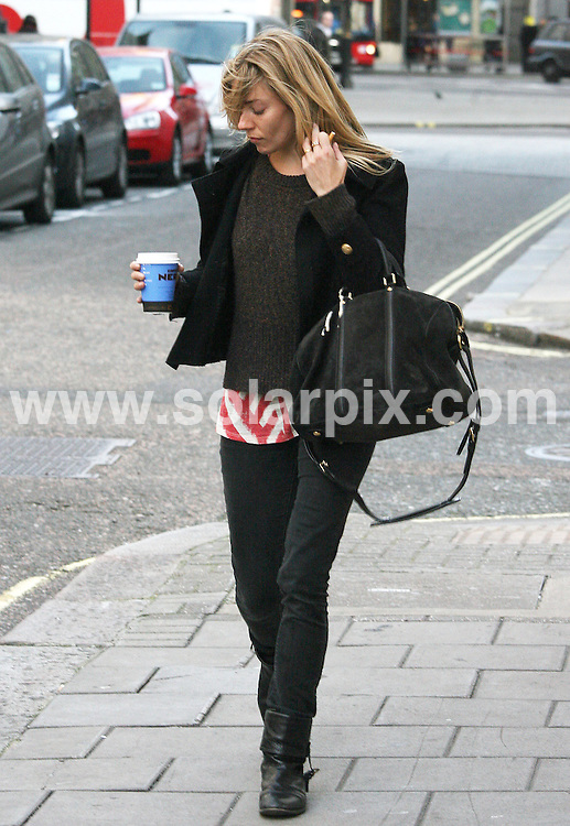 **ALL ROUND PICTURES FROM SOLARPIX.COM**                                             **WORLDWIDE SYNDICATION RIGHTS**                                                                                  Sienna Miller arrives for her first show of Terence Rattigan's Flare Path at the Theatre Royal Haymarket on Thursday 10 March 2010 in London                                                                        This pic:       Sienna Miller                                                                                        JOB REF:    12948    LNJ       DATE:     10.03.11                                                       **MUST CREDIT SOLARPIX.COM OR DOUBLE FEE WILL BE CHARGED**                                                                      **MUST AGREE FEE BEFORE ONLINE USAGE**                               **CALL US ON: +34 952 811 768 or LOW RATE FROM UK 0844 617 7637**