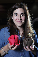 New York, NY, USA - June 24, 2011: Beth Johnson, original Origami designer and folder from Ann Arbor, Michigan, at the OrigamiUSA Convention in New York City holding two of her owl creations.