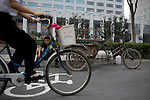 A recycling collector takes a break outside the Olympic Games venues in Beijing, China on Monday, August 4, 2008. Government officials ordered all unauthorized recycling collecting to stop during the Games.  The city of Beijing is gearing up for the opening ceremonies of the Olympic Games.  Kevin German
