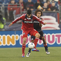 Chicago Fire midfielder Orr Barouch (15) attempts to control the ball as New England Revolution defender Kevin Alston (30) pressures. In a Major League Soccer (MLS) match, the New England Revolution defeated Chicago Fire, 2-0, at Gillette Stadium on June 2, 2012.