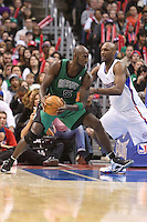 12/27/12 Los Angeles, CA: Boston Celtics power forward Kevin Garnett #5 and Los Angeles Clippers power forward Lamar Odom #7 during an NBA game between the Los Angeles Clippers and the Boston Celtics played at Staples Center. The Clippers defeated the Celtics 106-77 for their 15th straight win.