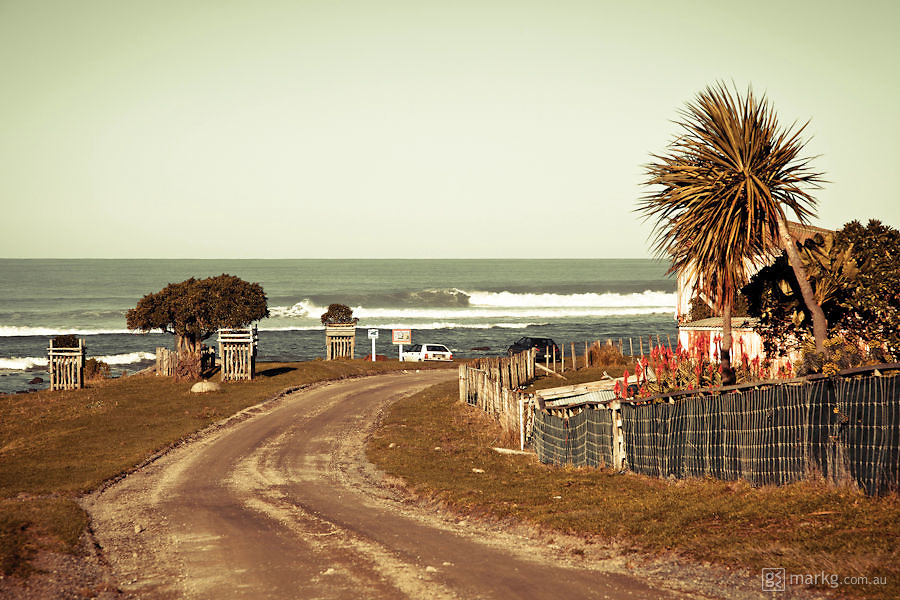 Rural gravel road down to an uncrowded Wairarapa surf break.