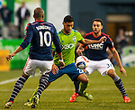 Seattle Sounders Lamar Neagle (27) battle for the ball <br /> against New England Revolution Teal Bunbury (10) during an MLS match on March 8, 2015 in Seattle, Washington.  The Sounders beat the Revolution 3-0.  Jim Bryant Photo. &copy;2015. All Rights Reserved.