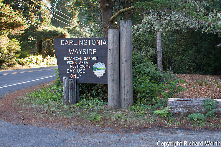 The Oregon State Parks Department sign at the parking lot entrance to Darlingtonia Wayside Botanical Garden north of Florence, Oregon.
