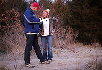 NWA Democrat-Gazette/DAVID GOTTSCHALK - 1/30/15 - Kevin Fitzpatrick (left),  professor of sociology and director of the University of Arkansas' Community and Family Institute, asks Angela Ritter answers questions near the woods where she lives south of Martin Luther King Jr. Boulevard in Fayetteville Friday January 30, 2015 at sunrise. Ritter participated in the Northwest Arkansas' biennial, 24-hour homeless census.