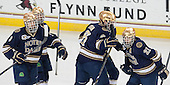 Shayne Taker (ND - 3), T.J. Tynan (ND - 18), Andy Ryan (ND - 6), Bryan Rust (ND - 21) - The Boston College Eagles defeated the visiting University of Notre Dame Fighting Irish 4-2 to tie their Hockey East quarterfinal matchup at one game each on Saturday, March 15, 2014, at Kelley Rink in Conte Forum in Chestnut Hill, Massachusetts.