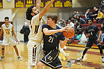 Eagle River's Ryan Adkins works against the defense of Dimond's  Kota Anuu.  Photo for the Star by Michael Dinneen