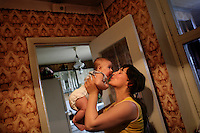 25 year old doctor Ala Roguti with her daughter Tanja in their apartment in Tiraspol, Transnistria. Also known as Trans-Dniestr or Transdniestria, Transnistria, located mostly on a strip of land between the Dniester River and the eastern Moldovan border with Ukraine, broke away from Moldova in 1990 and although a de facto independent state, governed by the Pridnestrovian Moldavian Republic (PMR), is not recognised internationally.