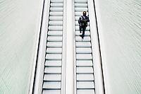 Nederland, Amsterdam, 13 mei 2014<br /> Reiziger op de nieuwe roltrappen in het verbouwde deel van Amsterdam Centraal station. <br /> <br /> Foto (c) Michiel Wijnbergh
