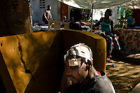 Port au Prince, Haiti, Jan 16 2010.The Central University Hospital is overwhelmed by the number of victims, many stay in the garden with almost no treatment for their often serious injuries as the hospital has run out of most medecine such as analgesics.