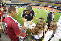 DC United Executive Chairman William H.C. Chang with fans.   The Houston Dynamo defeated DC United 3-1, at RFK Stadium, Saturday September 25, 2010.