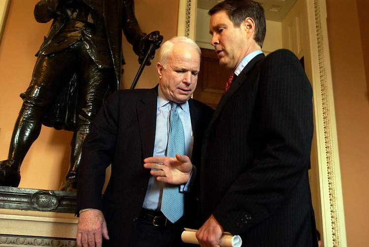 Senate Majority Leader Bill Frist, R-Tenn., right, confers with Sen. John McCain, R-Ariz., after the Senate Luncheons.