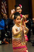 Young dancers perform in traditional costumes celebrating Lunar New Year, the Year of the Rooster.