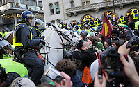 Police on horseback approach a group of protestors during a student demonstration in Westminster, central London on the day the government passed a bill to increase university tuition fees.