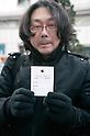March 16, 2012, Tokyo, Japan - A fan of the new iPad shows his ticket reservation, the paper shows the model, color and type of iPad that it will buy. .Fans lined up overnight outside the Apple store in Ginza, to buy the new iPad. Japan was one of the first countries where Apple fans could get their hands on the new iPad.
