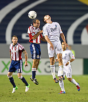 CARSON, CA - July 7, 2012: Chivas USA midfielder Nick LaBrocca (10) and Vancouver Whitecaps midfielder Alain Rochat (4) during the Chivas USA vs Vancouver Whitecaps FC match at the Home Depot Center in Carson, California. Final score Vancouver Whitecaps FC 0, Chivas USA 0.