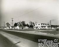 1945  October  19..         .No. 3.VA 44075 Liberty Park, Norfolk, VA.N side of Merrimac Avenue.Administration Building on left.Tenant Activity Building on right...NEG#.624-B.