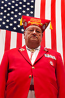 Allan Perkins, supreme chaplain of the military order of the Cootie, poses for a photo prior to the 2015 Veteran's Day Parade in downtown Houston.
