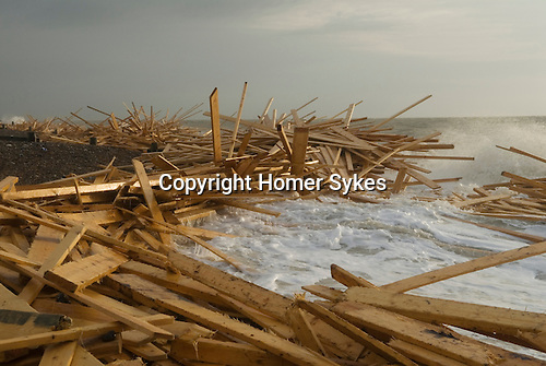 The beach at Worthing, West Sussex, England. Planks of wood from the freighter the &quot;Ice Prince&quot; which sank in rough weather on January 15th, came ashore a week later. January 21 2008.