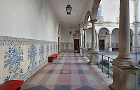 Internal courtyard with colonnaded balcony and azulejos tiles on the walls, at the University of Coimbra in the former Palace of the Alcazaba, Coimbra, Portugal. The University of Coimbra was first founded in 1290 and moved to Coimbra in 1308 and to the royal palace in 1537. The buildings are listed as a historic monument and a UNESCO World Heritage Site. Picture by Manuel Cohen