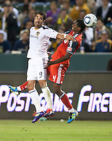 CARSON, CA – June 11, 2011: LA Galaxy forward Juan Pablo Angel (9) and Toronto FC defender Doneil Henry (4) during the match between LA Galaxy and Toronto FC at the Home Depot Center in Carson, California. Final score LA Galaxy 2, Toronto FC 2.